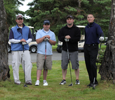 military golf team posing with golf clubs