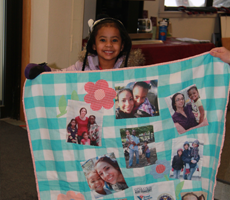 Little girl with kid comfort quilt