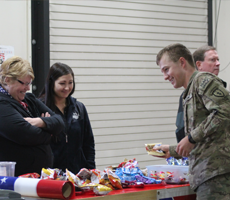 volunteers with soldier at snack attack