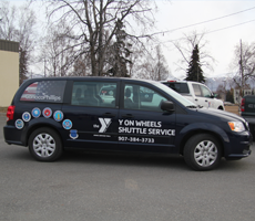 Y on Wheels Shuttle van
