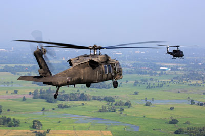 military helicopers flying over landscape