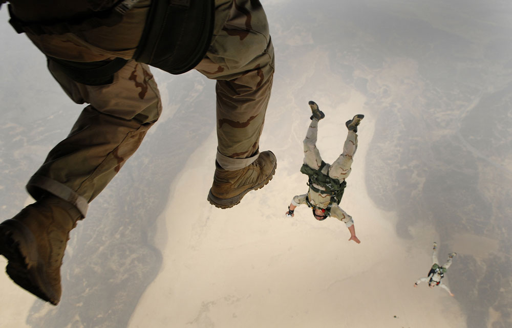 soldiers jumping from plane