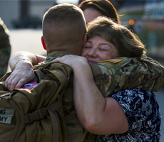soldier embracing mother