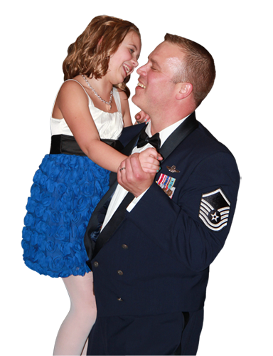 Airman in dress uniform holding his daughter