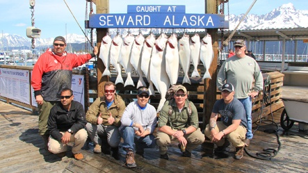 Combat fishing participants posing with their catch