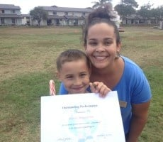 Mom and son with Operation Hero diploma