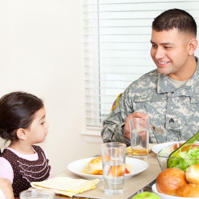 Military Father and Daughter at Dinner Table