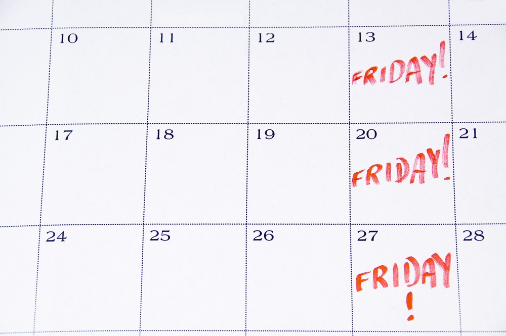 Close-up of white monthly calendar with FRIDAY! written in red.jpeg