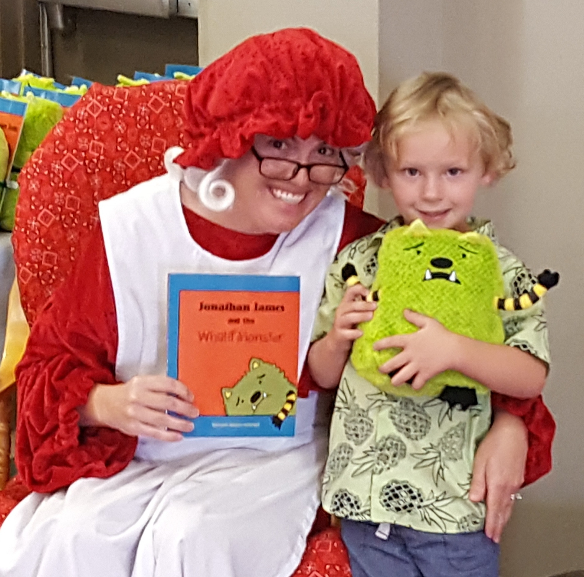 Mrs._Clause_with_book_and_plush-941211-edited.jpg